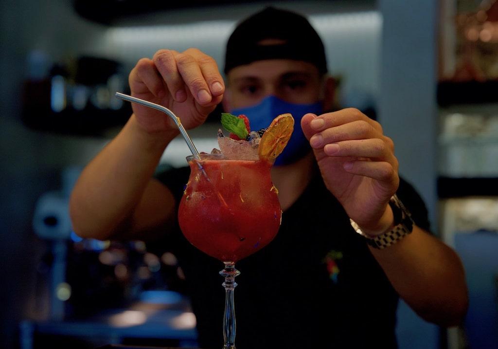 Barman preparing an Italian cocktail in Bellagio